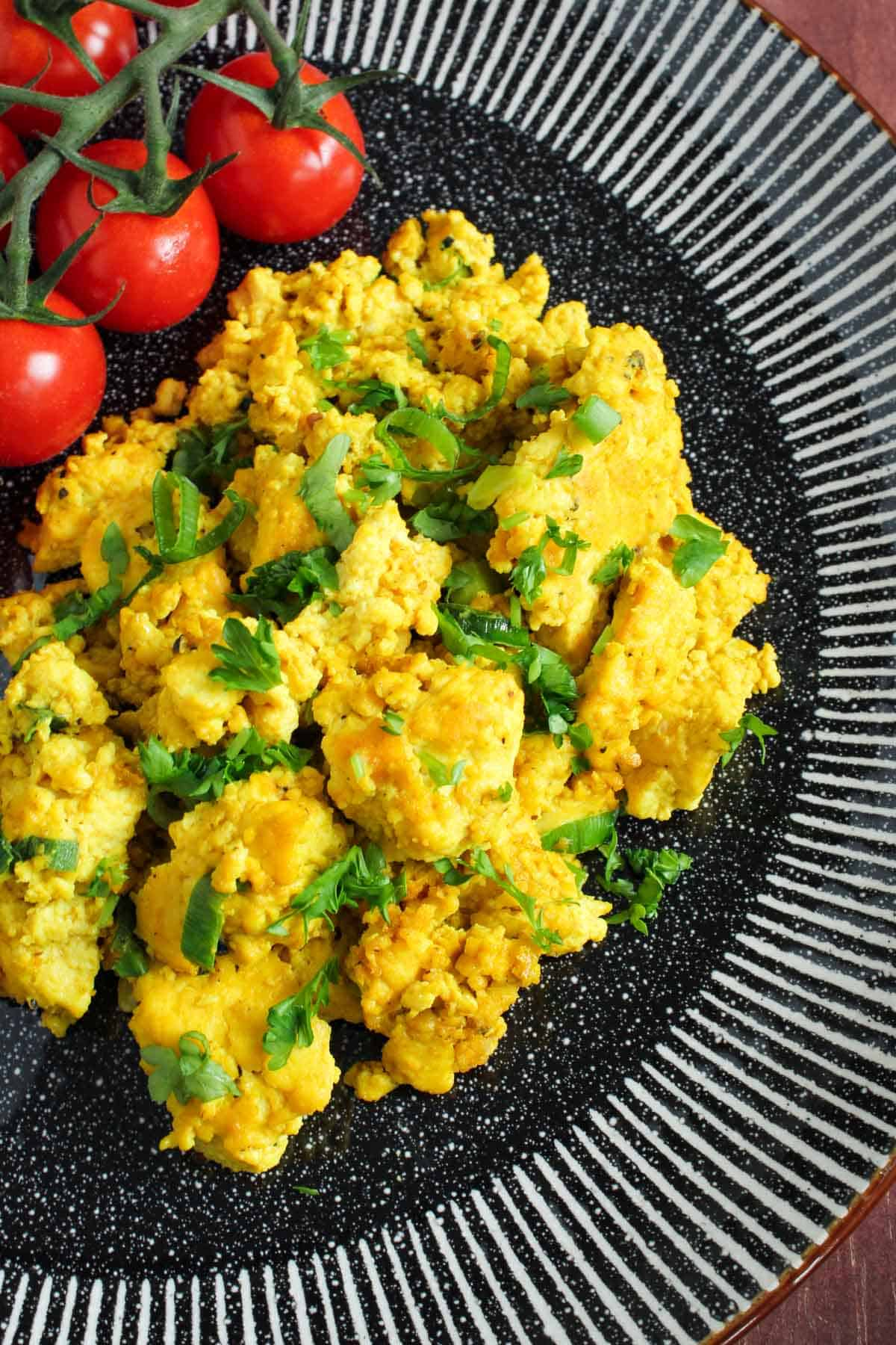 Vegan Scrambled Egg on Plate with Tomatoes