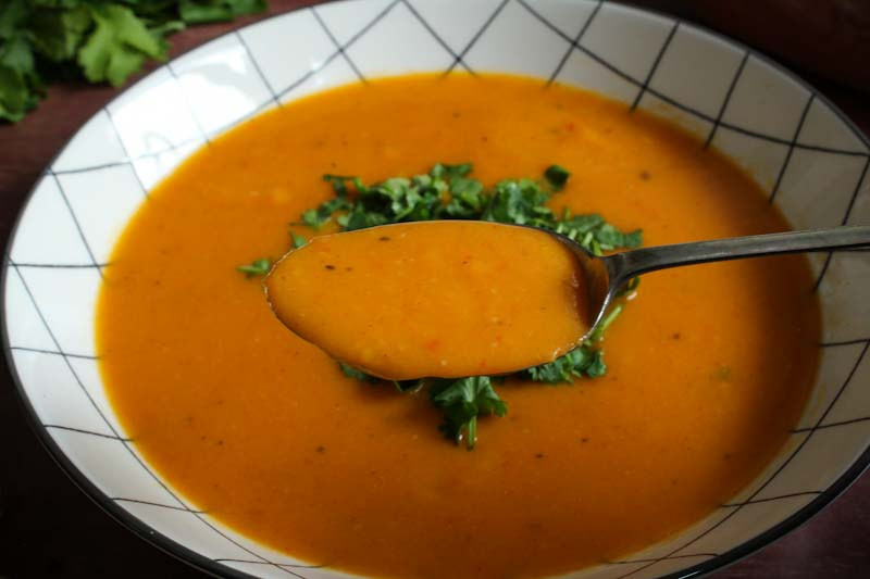 Vegan Sweet Potato and Coconut Soup on Spoon