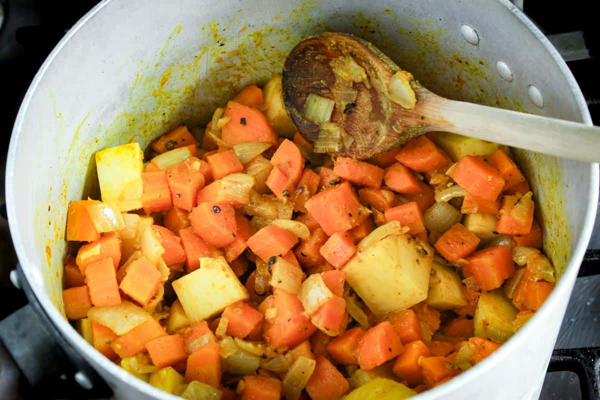 Carrots, Onions, and Potatoes Frying in Pan