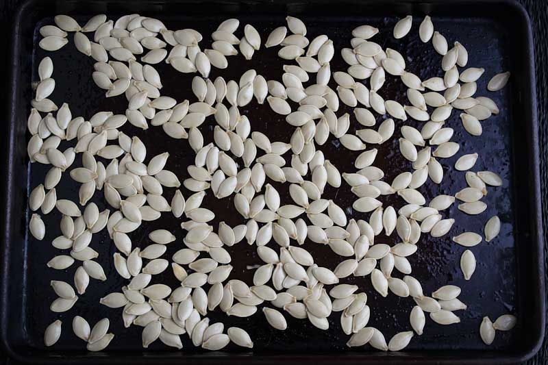 Uncooked Pumpkin Seeds on Baking Tray