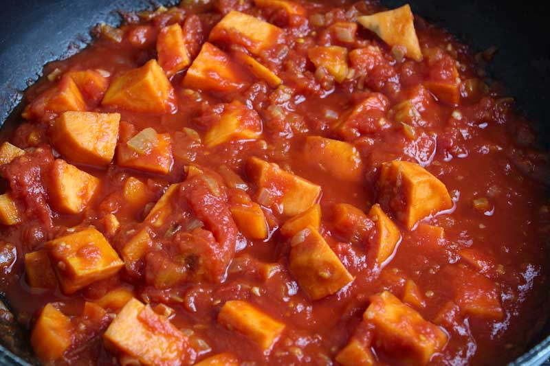 Sweet Potato Cubes and Tomatoes Cooking