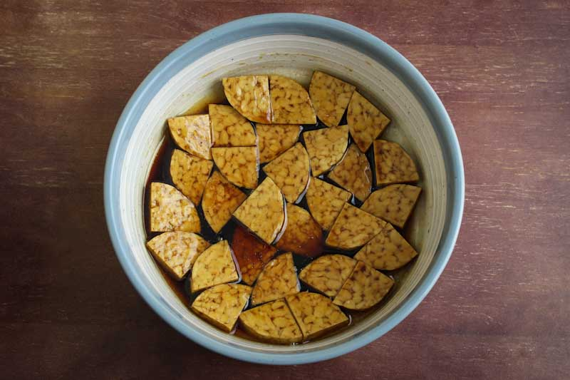 Tempeh Pieces Marinating in Bowl