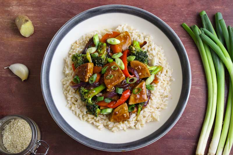 Tempeh and Vegetable Stir-Fry in Serving Bowl with Rice