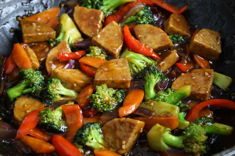 Teriyaki Tempeh Stir-Fry in Wok Close-Up