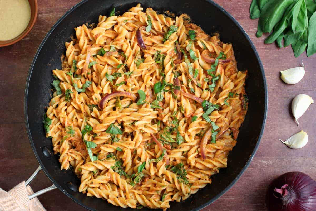 Tomato Tahini Sauce Mixed with Pasta in Pan