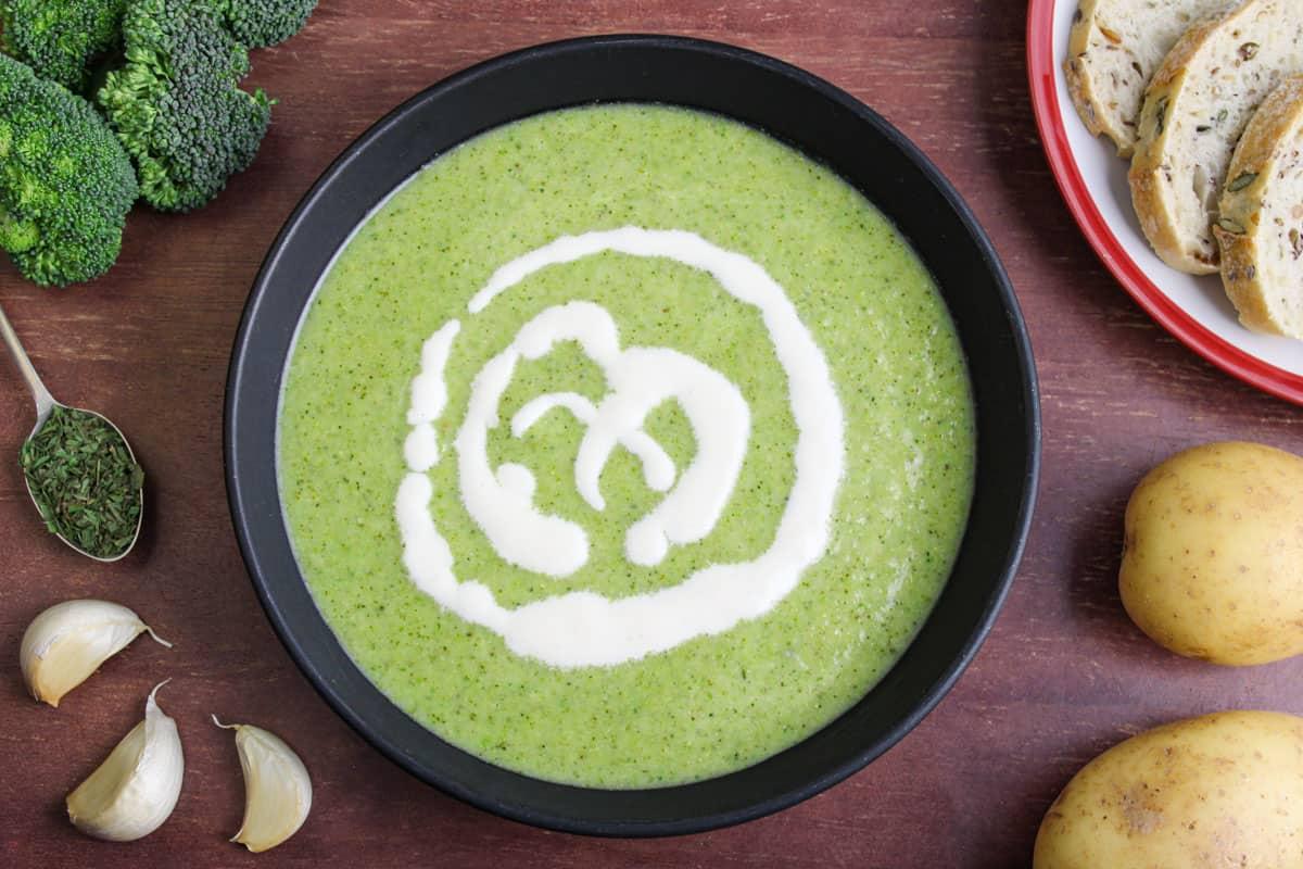 Broccoli Potato Soup in Bowl with Bread
