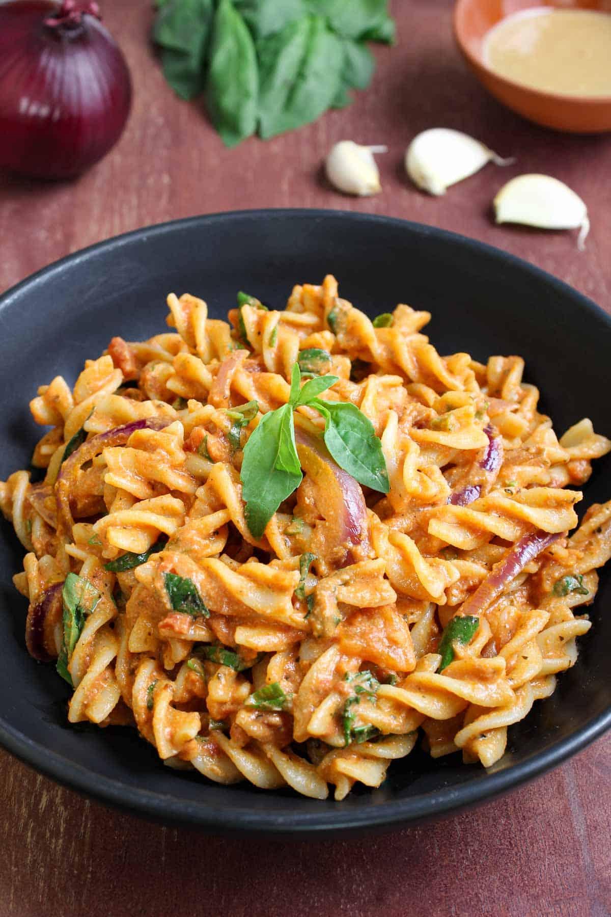 Creamy Tahini Pasta with Tomatoes and Basil