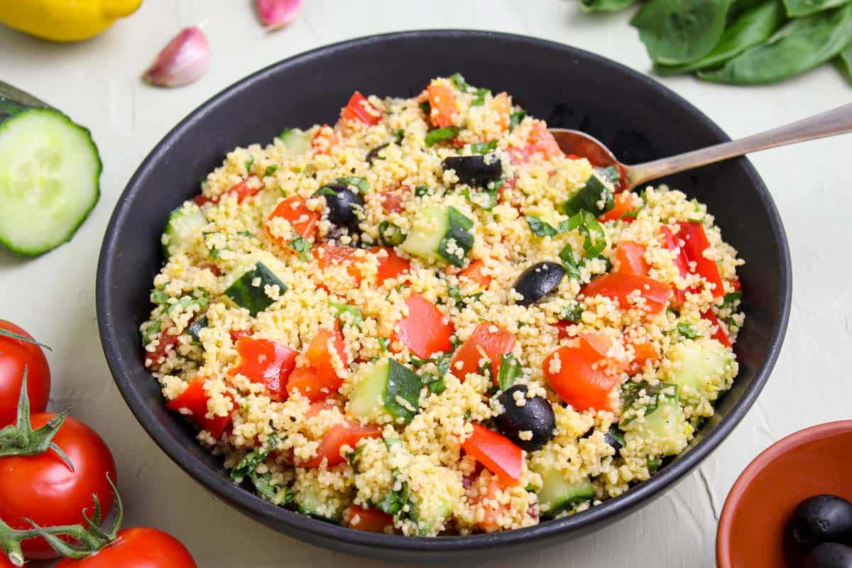 Couscous Salad in Bowl with Serving Spoon