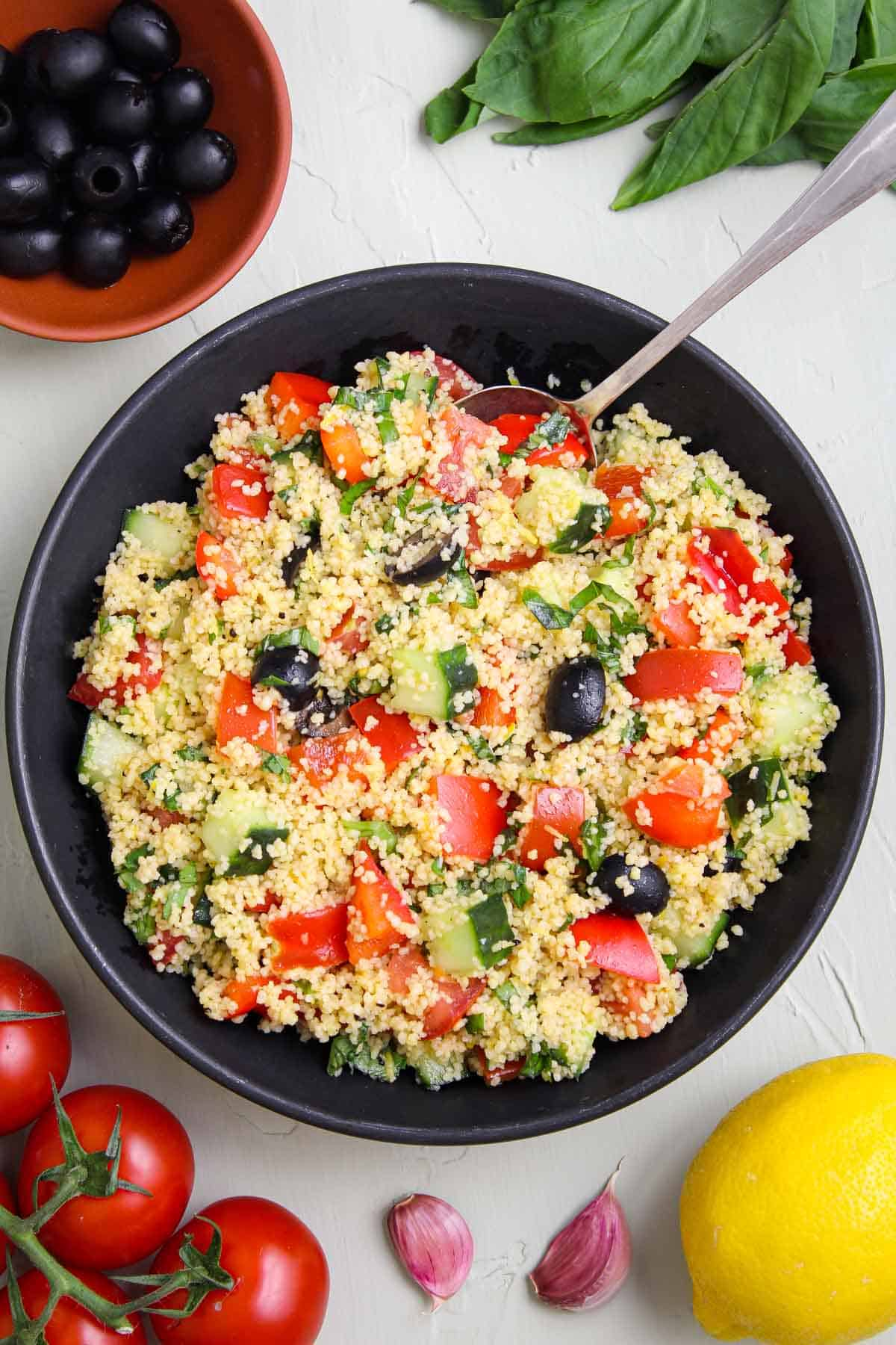 Vegan Couscous Salad Overhead with Lemon, Tomatoes, Olives, Basil, Garlic