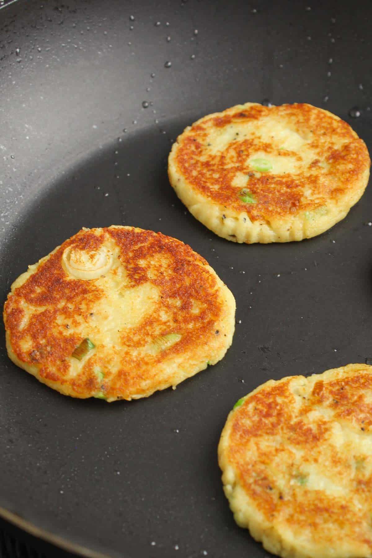Crispy Vegan Potato Cakes Frying in Pan