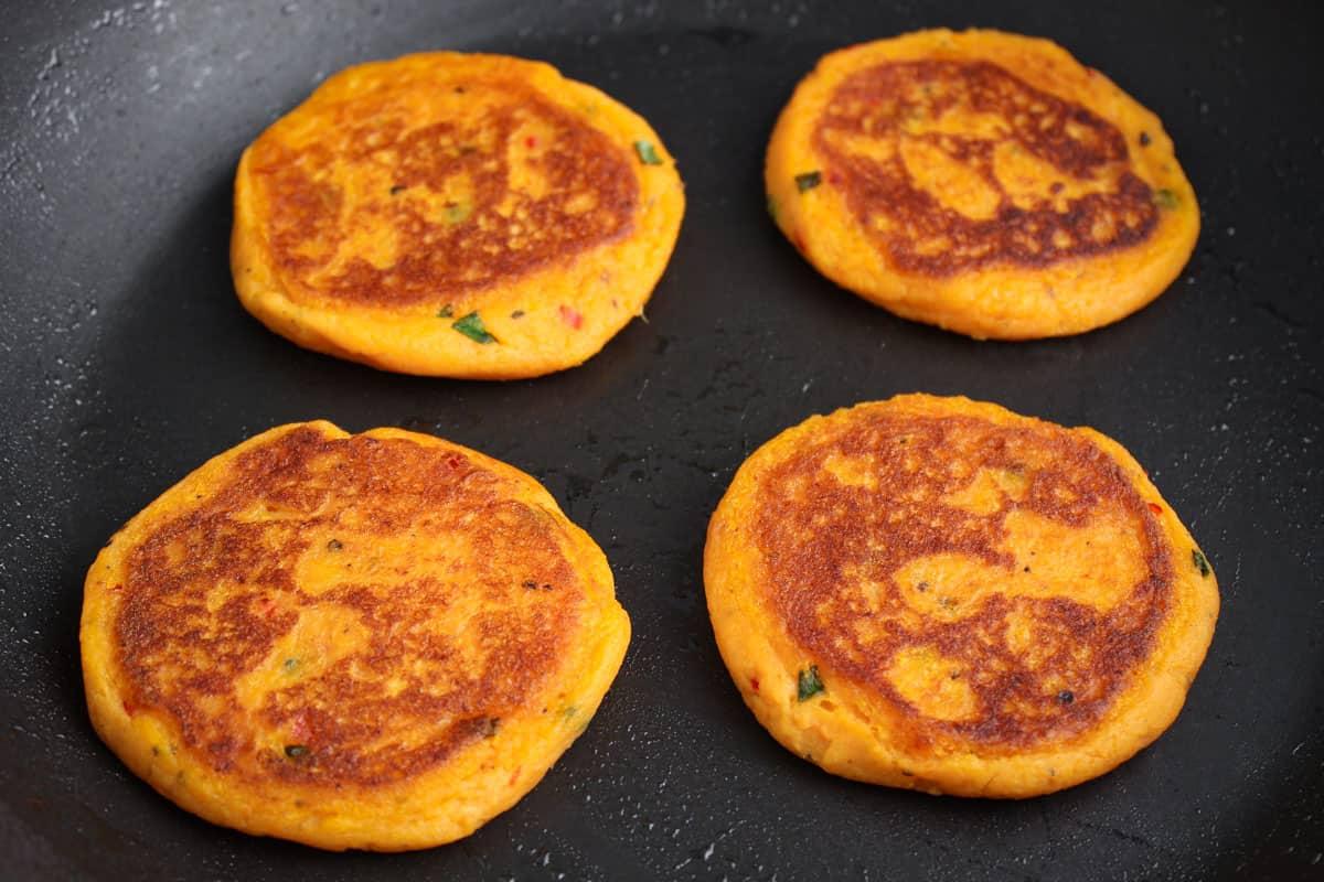Gluten-Free Sweet Potato Pancakes Frying in Pan
